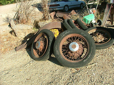 Old Antique Car Parts A pair of 1920's Chevy 19 inch  spoke wheel with tires