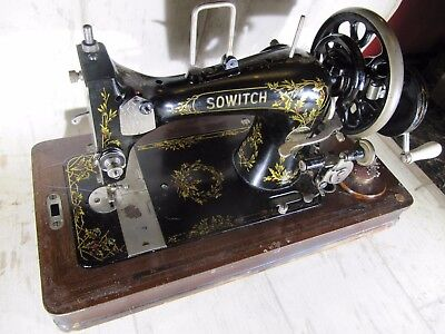 Vintage Hand Cranked Sewing Machine with beautiful festive holly design