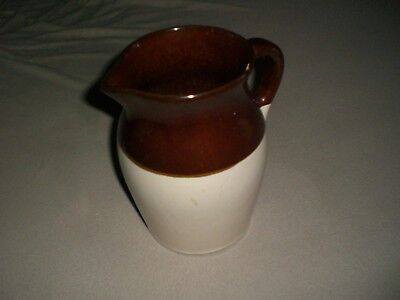 """R.R.P. Co Roseville #121-1 Stoneware Pitcher, 9"""" tall."""