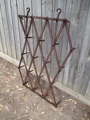 Antique cast iron scarifier. Plough harrow statue garden.Bookshelf stand rack