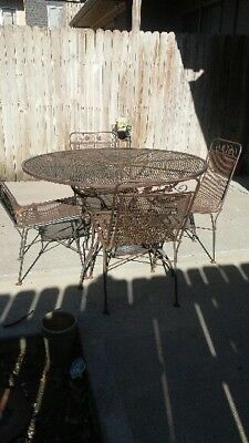 Sturdy Salterini Wrought Iron Outside Patio Table and 4 Chairs.