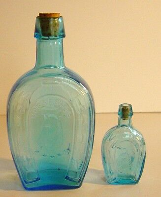 Vintage Pair of Horseshoe Blue Bottles with corks (B3)