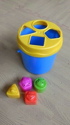 Unisex shape sorter with four shapes. Good condition. Yellow and blue