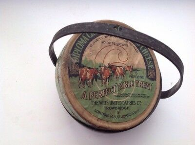 vintage old round cheese box in silver mount