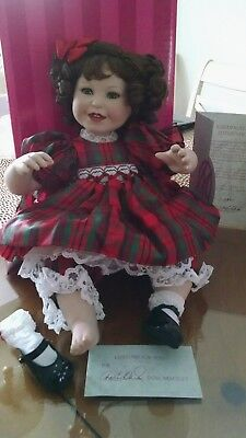 """We Wish You A Merry Christmas"" playing music Marie Osmond Collectible Doll"
