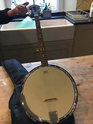 4-string bango, hardly played and comes with padded case