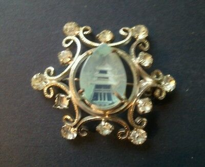 Vintage 1930s asian pagoda aqua glass reverse carved white metal brooch