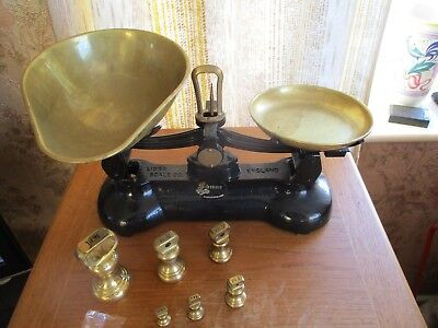 labrasco  cast iron vintage scales with brass scoops and 7 bell weights