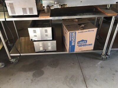 Used stainless steel prep table with casters