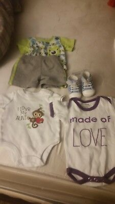 newborn baby clothes. Tons of different brands. Perfect condition