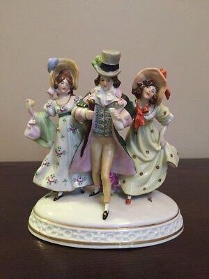 Capodimonte Figurine #12134 - Man And Two Ladies Strolling