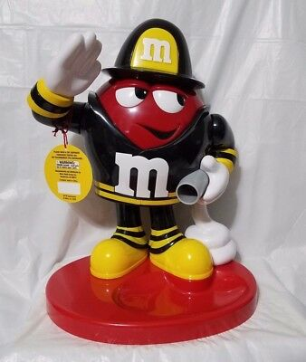 M&M's World Fireman Candy Dispenser. Made on Red Plastic.