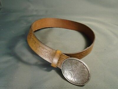 Belt with belt buckle size 30-34, more if you hole punch.