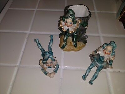 Figurines and vase made in occupied japan jesters. Green tones
