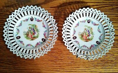 Vintage Germany Pair Mini Hanging Plates Tryst Scene Centers w / Open Work Edges