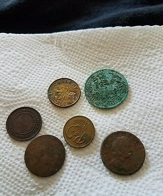 Six old coins dug in England