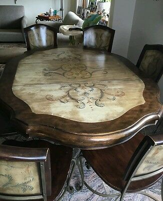 Antique  solid cherry wood dining room table and 6 wrought iron chairs!!!!