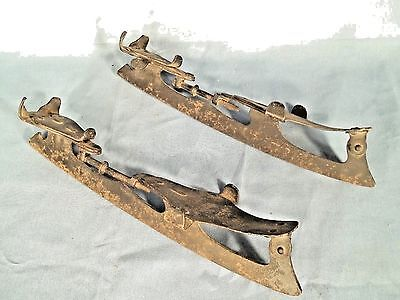 PAIR OF ANTIQUE IRON EARLY 20th CENTURY ICE SKATES