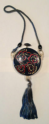 CELLULOID compact purse - circa 1920s - deco red, white & gold on blue design