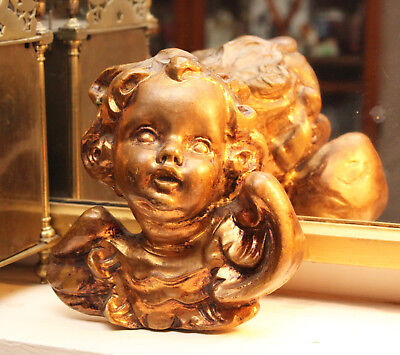 A Finely Carved and Gilded Wooden Wall Hanging Cherub or Putti