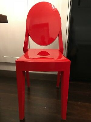 4 red kartell victoria ghost chairs designed by philippe starck