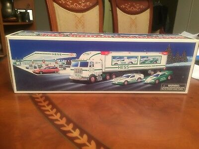 1997 Hess Toy Truck and Racers Unopened In Original Box (2) Race Cars Included