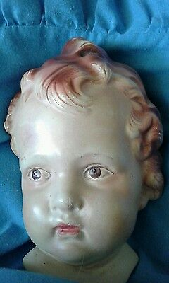 Vintage decorative chalkware wall plaques baby's face