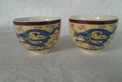 Two Asian Tea Cups Yellow With Blue Dragon