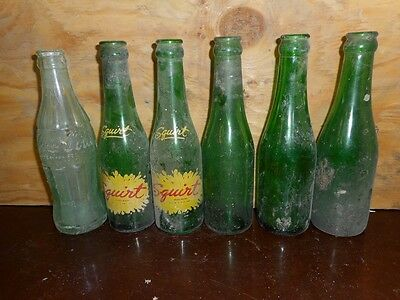 Lot of 6 bottles 7 oz Squirt , Coca Cola and unmarked Pop Bottles -AS IS