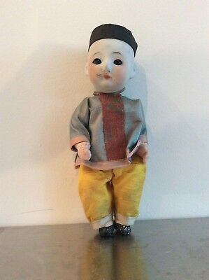 Vintage Miniture composition an bisque oriental doll with glass eyes Chinese man