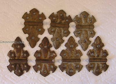 seven matching antique cast metal Fleur de Lis flush cabinet door hinges