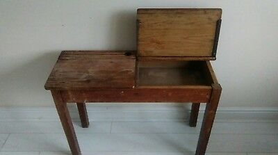 old pitch pine double school desk with ink wells graffitti. Original industrial.