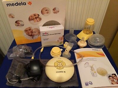 Medela Swing Electric Breast Pump boxed and all parts great condition + extras
