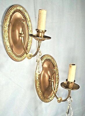 PAIR OF ANTIQUE EARLY 20th CENTURY GARLAND DECORATED OVAL BACK BRASS SCONCES