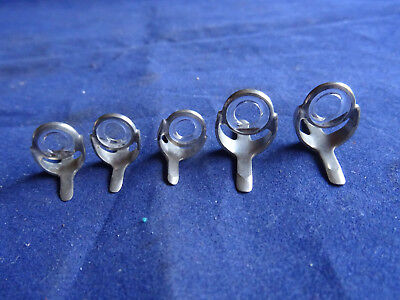 A Selection Of Old Shop Stock Vintage Glass Lined Rod Rings