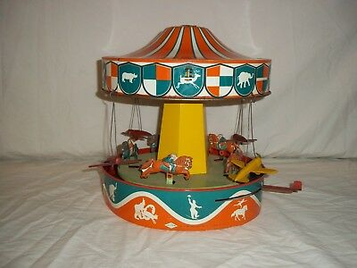 VINTAGE 1930s WOLVERINE MUSICAL LITHOGRAPHED TIN CAROUSEL LEVER ACTION WORKING