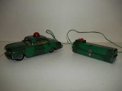 Vintage Line Mar Battery Operated tin police type car w/ control works great