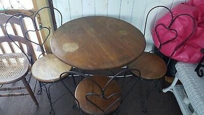 VINTAGE ANTIQUE ICE CREAM PARLOR SET  Twisted IRON OAK TABLE AND 3 CHAIRS