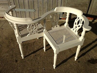 A Victorian Ivory Painted Tete A Tete with cane seats...