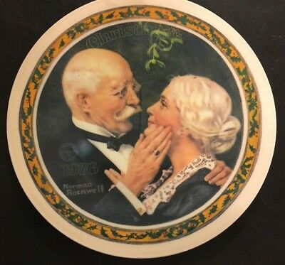 """NORMAN ROCKWELL"" PORCELAIIN PLATE titled ""GOLDEN CHRISTMAS"" - 1976 - 8"" IN DIA."