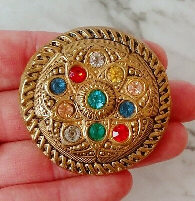 Antique Egyptian Revival Stamped Brass Round Repousse Glass Rhinestone Brooch