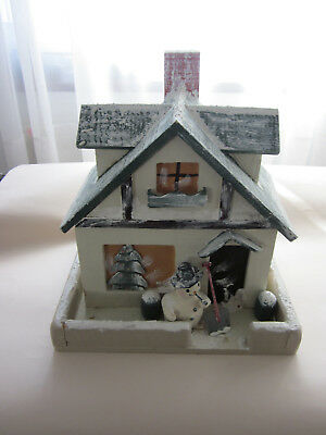 Folk art - handmade wooden house - winter scene