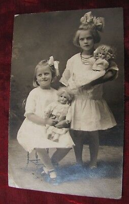 Two Girls with DOLLS & Bows ~ Photo Postcard~1900 ~ Antique Vtg RPPC doll
