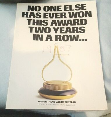 Motor Trend Car of the Year Ad for 1986 Ford Taurus & 1987 Ford Thunderbird