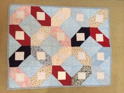 Handmade baby quilt in blue, red, and pink, gender neutral