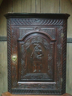 fine 18th century carved oak corner cabinet dated 1717 on stand cavalier soldier