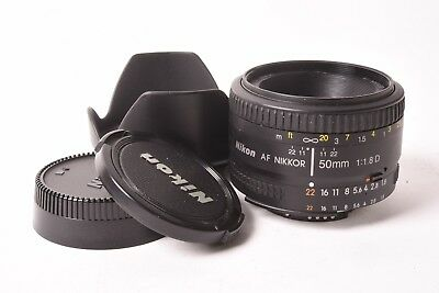 Nikon AF Nikkor f/1.8 D - 50mm. With lens hood, front and rear capsules