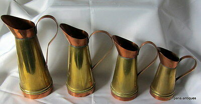 Antique set of 4 copper and brass cream measures/jugs