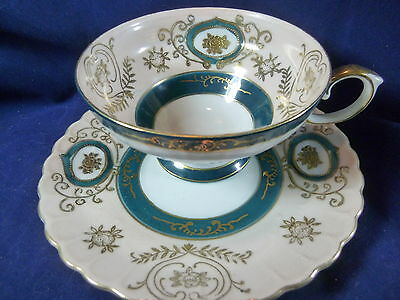 Ucagco Tea Cup And Saucer Dramatic Green And White Raised Gilt Floral Motif