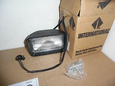 International Navistar FOG LIGHT WITH HARDWARE  1619999C92  NEW   507**Last One